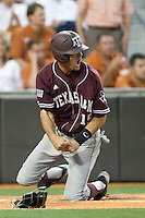 Texas A&M Aggies shortstop Kenny Jackson #15 celebrates scoring a run against the Texas Longhorns in NCAA Big XII Conference baseball on May 21, 2011 at Disch Falk Field in Austin, Texas. (Photo by Andrew Woolley / Four Seam Images)