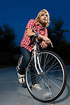 USA, Illinois, Peoria, Portrait of young man on bike at dusk