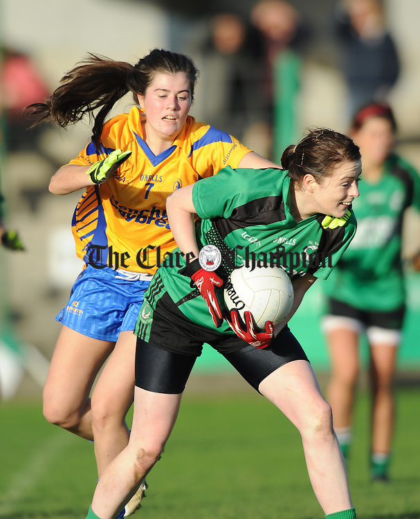 Orlaith Lynch of The Banner in action against Louise Coholan of St Valentine's during their Senior Ladies Munster football final at Kilmallock. Photograph by John Kelly.