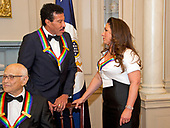 Lionel Richie and Gloria Estefan, two of the five recipients of the 40th Annual Kennedy Center Honors, converse after posing for a group photo following a dinner hosted by United States Secretary of State Rex Tillerson in their honor at the US Department of State in Washington, D.C. on Saturday, December 2, 2017.  Norman Lear can be seen at the lower left corner. The 2017 honorees are: American dancer and choreographer Carmen de Lavallade; Cuban American singer-songwriter and actress Gloria Estefan; American hip hop artist and entertainment icon LL COOL J; American television writer and producer Norman Lear; and American musician and record producer Lionel Richie.  <br /> Credit: Ron Sachs / Pool via CNP