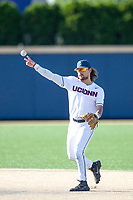 Connecticut Huskies second baseman Christian Fedko (7) makes a throw to first base during the NCAA tournament against the Michigan Wolverines on June 4, 2021 at Frank Eck Stadium in Notre Dame, Indiana. The Huskies defeated the Wolverines 6-1. (Andrew Woolley/Four Seam Images)