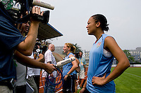 USWNT midfielder Angela Hucles and teammate Lori Chalupny talk to the media following practice at Beijing Normal University in preparation for the Olympic gold medal game at Workers' Stadium in Beijing, China.