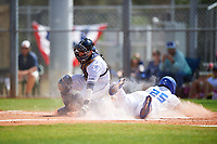 South Dakota State Jackrabbits Josh Kutzke (25) slides home safely as catcher Luis Chavez (9) attempts to field a throw during a game against the FIU Panthers on February 23, 2019 at North Charlotte Regional Park in Port Charlotte, Florida.  South Dakota State defeated FIU 4-3.  (Mike Janes/Four Seam Images)