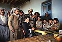 Iran 1979.Peshmergas of KDPI resting in a tea house, in the middle ,in black Rahman Haji Ahmadi  Iran 1979 Peshmergas du PDKI se reposant dans une maison de thé, assis en noir, Rahman Haji Ahmadi
