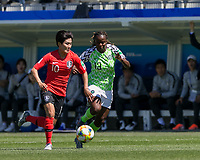 GRENOBLE, FRANCE - JUNE 12: Soyun Ji #10 of the Korean National Team dribbles at midfield as Ngozi Okobi #13 of the Nigerian National Team defends during a game between Korea Republic and Nigeria at Stade des Alpes on June 12, 2019 in Grenoble, France.