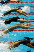 Women backstroke start blur.