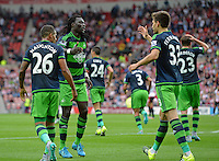 Bafetibis Gomis (2nd from left) of Swansea City celebrates scoring their first goal with team mates during the Barclays Premier League match between Sunderland and Swansea City played at Stadium of Light, Sunderland