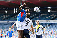 Ellis Harrison of Portsmouth wins a header from Josh Ruffels of Oxford United during Portsmouth vs Oxford United, Sky Bet EFL League 1 Play-Off Semi-Final Football at Fratton Park on 3rd July 2020