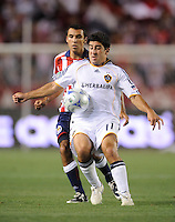 Los Angeles Galaxy's (11) Alecko Eskandarian moves the ball up field during a game against the Chivas USA at the Home Depot Center. Los Angeles Galaxy 1-0 over the Chivas USA, Saturday, Jul. 11. 2009, in Carson, California.