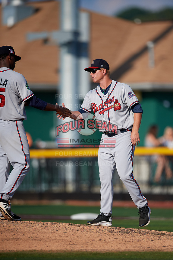 Danville Braves manager Barrett Kleinknecht (5) shakes hands with starting pitcher Jose Montilla (45) after making a pitching change during a game against the Johnson City Cardinals on July 29, 2018 at TVA Credit Union Ballpark in Johnson City, Tennessee.  Johnson City defeated Danville 8-1.  (Mike Janes/Four Seam Images)