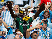An Argentina fan dressed as a cow