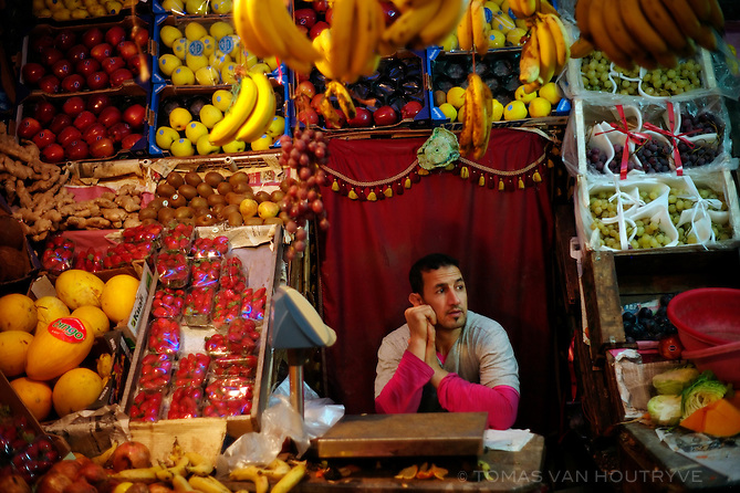 A fruit vendor is seen inside the market in Dakhla, Morocco on Dec. 16, 2011.