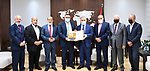 Palestinian Prime Minister Mohammed Ishtayeh receives the annual report of the retirement authority for the year 2020, in the West Bank city of Ramallah on September 28, 2021. Photo by Prime Minister Office