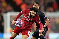 Liverpool's Mohamed Salah battles with Atletico Madrid's Renan Lodi <br /> <br /> Photographer Rich Linley/CameraSport<br /> <br /> UEFA Champions League Round of 16 Second Leg - Liverpool v Atletico Madrid - Wednesday 11th March 2020 - Anfield - Liverpool<br />  <br /> World Copyright © 2020 CameraSport. All rights reserved. 43 Linden Ave. Countesthorpe. Leicester. England. LE8 5PG - Tel: +44 (0) 116 277 4147 - admin@camerasport.com - www.camerasport.com