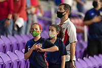 ORLANDO, FL - JANUARY 22: USA Supporters during the National Anthem prior to a game between Colombia and USWNT at Exploria stadium on January 22, 2021 in Orlando, Florida.