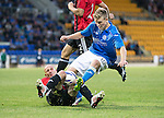 St Johnstone v FC Spartak Trnava...31.07.14  Europa League 3rd Round Qualifier<br /> Marek Janecka puts in a crunching tackle on David Wotherspoon<br /> Picture by Graeme Hart.<br /> Copyright Perthshire Picture Agency<br /> Tel: 01738 623350  Mobile: 07990 594431