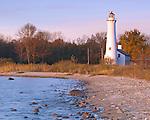 Alcona County, MI: Early morning light on Sturgeon Point Lighthouse (1870) on Lake Huron in autumn
