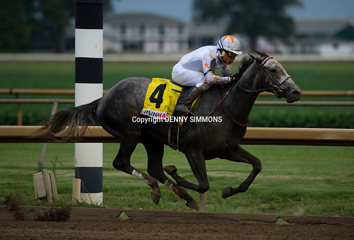 Jockey Rafael Bejarano rides Crazy Beautiful to a first place finish in the sixth race at Ellis Park in Henderson, Ky., Sunday afternoon, Aug. 9, 2020.