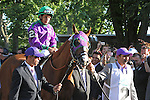 June 7, 2014: California Chrome is greeted by enthusiastic fans as walks in the paddock before the Belmont Stakes.Willie Delgado, left, and Raul Rodriguez lead the colt; Victor Espinoza is aboard. Tonalist, trained by Christophe Clement and ridden by Joel Rosario wins the 146th running of the Grade I Belmont Stakes at Belmont Park , Elmont, NY.   ©Joan Fairman Kanes/ESW/CSM