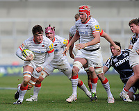 20130310 Copyright onEdition 2013©.Free for editorial use image, please credit: onEdition..Ernst Joubert of Saracens attacks as he is supported by Mouritz Botha (right) and Nick Fenton-Wells of Saracens during the LV= Cup semi final match between Sale Sharks and Saracens at the Salford City Stadium on Sunday 10th March 2013 (Photo by Rob Munro)..For press contacts contact: Sam Feasey at brandRapport on M: +44 (0)7717 757114 E: SFeasey@brand-rapport.com..If you require a higher resolution image or you have any other onEdition photographic enquiries, please contact onEdition on 0845 900 2 900 or email info@onEdition.com.This image is copyright onEdition 2013©..This image has been supplied by onEdition and must be credited onEdition. The author is asserting his full Moral rights in relation to the publication of this image. Rights for onward transmission of any image or file is not granted or implied. Changing or deleting Copyright information is illegal as specified in the Copyright, Design and Patents Act 1988. If you are in any way unsure of your right to publish this image please contact onEdition on 0845 900 2 900 or email info@onEdition.com