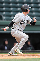 Center fielder Justin Allen (10) of the USC Upstate Spartans bats in a game against the Furman University Paladins on Tuesday, March 4, 2013, at Fluor Field at the West End in Greenville, South Carolina. Furman won, 13-1. (Tom Priddy/Four Seam Images)