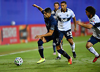 LAKE BUENA VISTA, FL - JULY 26: Alan Pulido of Sporting KC dribble away from pressure during a game between Vancouver Whitecaps and Sporting Kansas City at ESPN Wide World of Sports on July 26, 2020 in Lake Buena Vista, Florida.