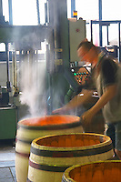 Burning, toasting the barrel with fire. Cooperage, barrel manufacturing, Cadus, Louis Jadot, Ladoix, Beaune, Burgundy, France