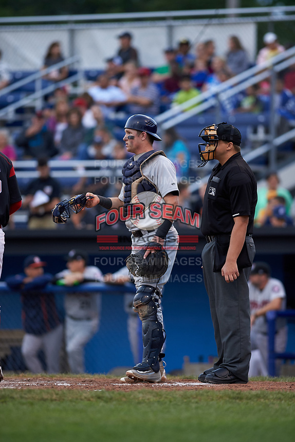 Umpire John Boccio and Tri-City ValleyCats catcher Michael Papierski (9) during a game against the Batavia Muckdogs on July 14, 2017 at Dwyer Stadium in Batavia, New York.  Batavia defeated Tri-City 8-4.  (Mike Janes/Four Seam Images)