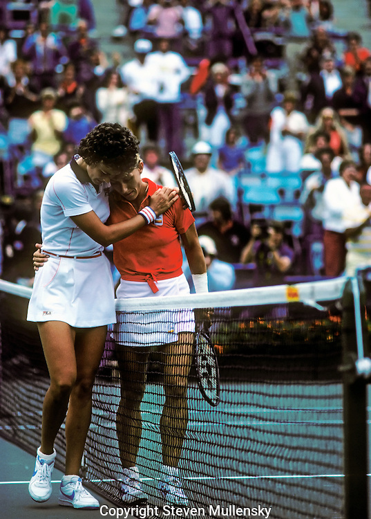 Pam Shriver and Martin Navratilova hug each other while leaving the court after Navratilove won their fourth round match during the 1981 US Tennis Championships in Flushing Meadow, New York. Pamela Howard Shriver Lazenby (born July 4, 1962, in Baltimore, Maryland), is a former professional tennis player and current sports broadcaster from the United States. During the 1980s and 1990s, she won 133 top-level titles, including 22 women's doubles titles and 1 mixed doubles title at Grand Slam tournaments. She also won a women's doubles gold medal at the 1988 Olympic Games in Seoul, partnering with Zina Garrison..Martina Navratilova (born October 18, 1956, in Prague, Czechoslovakia) is a former World No. 1 woman tennis player.