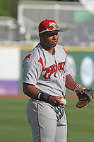 Carolina Mudcats first baseman Jesus Aguilar #10 warming up in the outfield before the first game of a doubleheader against the Myrtle Beach Pelicans at Tickerreturn.com Field at Pelicans Ballpark on May 10, 2012 in Myrtle Beach, South Carolina. Myrtle Beach defeated Carolina by the score of 2-1. (Robert Gurganus/Four Seam Images)