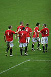 FC United of Manchester 8, Glossop North End 0, 28/10/2006. Gigg Lane, Bury, North West Counties League division one. FC United of Manchester players celebrated another goal as their team deafeat Glossop North End (blue shirts) 8-0 in a North West Counties division one match at United's home stadium, Gigg Lane, home to Bury FC. The match was staged on People United Day, an event started in 1999 which brought together fans from across Europe to campaign against racism. FC United were formed in the summer of 2005 by supporters of Manchester United in response to the take over of their club by American millionaire Malcolm Glazer and his family. The club entered the football pyramid at the lowest level with the intention to climbing through the leagues. FCUM won the match 8-0, watched by 3257 spectators. Photo by Colin McPherson.