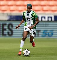 HOUSTON, TX - JUNE 10: Rasheedat Ajibade #15 of Nigeria dribbles the ball during a game between Nigeria and Jamaica at BBVA Stadium on June 10, 2021 in Houston, Texas.