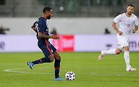 ST. GALLEN, SWITZERLAND - MAY 30: Kellyn Acosta #23 of the United States looks for an open man downfield during a game between Switzerland and USMNT at Kybunpark on May 30, 2021 in St. Gallen, Switzerland.