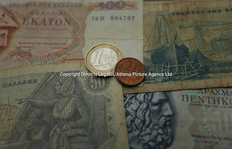 An o ld drachma coin and a one euro coin on old drachma paper notes<br /> Re: The forthcoming elections in Greece has severely de-stabilised the currency and stock markets in Europe and the rest of the world.