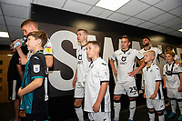 Jay Fulton, Bersant Celina and Connor Roberts of Swansea City interacts with a young mascot during the Sky Bet Championship match between Swansea City and Nottingham Forest at the Liberty Stadium in Swansea, Wales, UK. Saturday 14 September 2019