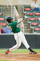 Greensboro Grasshoppers third baseman Yordy Cabrera (25) follows through on his swing against the Kannapolis Intimidators at CMC-Northeast Stadium on July 12, 2013 in Kannapolis, North Carolina.  The Grasshoppers defeated the Intimidators 2-1.   (Brian Westerholt/Four Seam Images)