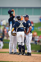 West Michigan Whitecaps pitching coach Mark Johnson (37) talks with pitcher Joe Jimenez (left) and catcher Franklin Navarro (12) during a game against the Cedar Rapids Kernels on June 7, 2015 at Fifth Third Ballpark in Comstock Park, Michigan.  West Michigan defeated Cedar Rapids 6-2.  (Mike Janes/Four Seam Images)