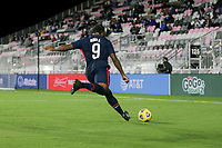 FORT LAUDERDALE, FL - DECEMBER 09: Ayo Akinola #9 of the United States sends a cross ball into the box during a game between El Salvador and USMNT at Inter Miami CF Stadium on December 09, 2020 in Fort Lauderdale, Florida.