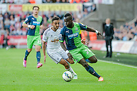 Saturday 4th  October 2014 Pictured: ( L-R )  Neil Taylor of Swansea City and Cheik Ismael Tiote of Newcastle United<br /> Re: Barclays Premier League Swansea City v Newcastle United at the Liberty Stadium, Swansea, Wales,UK