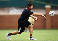 WINSTON-SALEM, NORTH CAROLINA - September 01, 2013:<br />  Andrew Quinn, goalie coach of Louisville University throws to one of his players during a match at the Wake Forest Invitational tournament at Wake Forest University on September 01. The match was abandoned early in the second half due to severe weather with Wake leading 1-0.