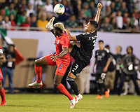 CHICAGO, IL - JULY 7: Gyasi Zardes #9 and Carlos Salcedo #3 go for the ball during a game between Mexico and USMNT at Soldiers Field on July 7, 2019 in Chicago, Illinois.