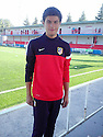 """Collect pic of Josuha Rae, who is 6' 1"""" despite only being 12 years old, at Atletico de Madrid's school of football."""