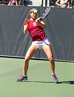 STANFORD, CA - MARCH 1, 2015--Stanford women tennis player Ellen Tsay, returns the ball back to a CAL Berkley player during Sunday's match at the Taube Family Tennis Stadium.