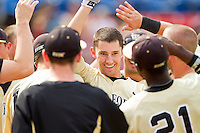 Evan Stephens #5 of the Wake Forest Demon Deacons is congratulated by his teammates after hitting a home run against the Virginia Tech Hokies at Wake Forest Baseball Park on April 21, 2012 in Winston-Salem, North Carolina.  The Demon Deacons defeated the Hokies 8-6.  (Brian Westerholt/Four Seam Images)