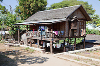 Myanmar, Burma.  Mingun, near Mandalay.  Typical Rural Village House, Living Area Raised on Stilts above the Ground, Sitting and Storage Space Underneath.