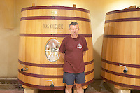 Guilhem Bruguière Domaine Mas Bruguiere. Pic St Loup. Languedoc. Wooden fermentation and storage tanks. Owner winemaker. France. Europe.