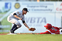 Staten Island Yankees second baseman Ty McFarland (14) tags out Mason Davis (7) sliding into second during a game against the Batavia Muckdogs on August 8, 2014 at Dwyer Stadium in Batavia, New York.  Staten Island defeated Batavia 4-2.  (Mike Janes/Four Seam Images)