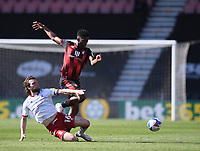 2nd April 2021; Vitality Stadium, Bournemouth, Dorset, England; English Football League Championship Football, Bournemouth Athletic versus Middlesbrough; Jonathan Howson of Middlesbrough slides in and tackles Jefferson Lerma of Bournemouth
