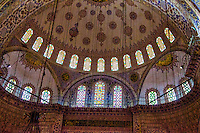 Fine Art Travel Photograph of the interior of the Sultan Ahmed Mosque also known as the Blue Mosque in Istanbul Turkey.