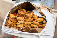 Peru, Cusco.  Pastries Being Sold by a Street Vendor.